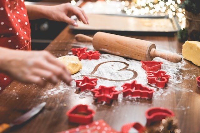 Photo of hands making holiday cookies illustrates some of the tasks that may create the fatigue discussed in the article